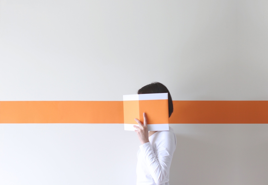 0111-Getty-Images-Side-view-of-a-mature-woman-hiding-her-face-behind-a-book-Pchyburrs-Getty-Images.jpg