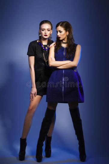 fashion-models-posing-blue-background-two-56165067